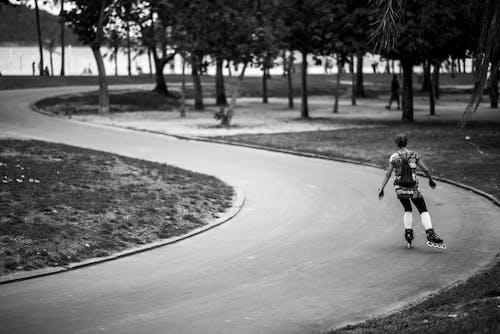 Active man roller skating in park