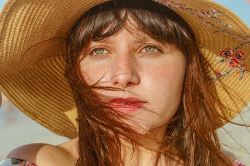 Woman Wearing Brown Sun Hat