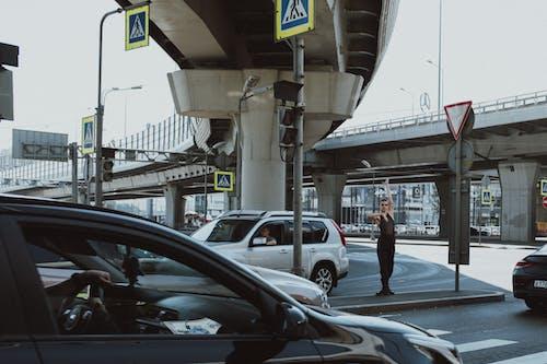 Man in Black Jacket Standing Beside Black Car