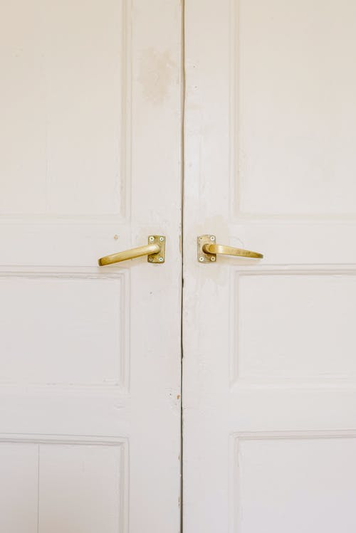 Modern white house doors with golden handles