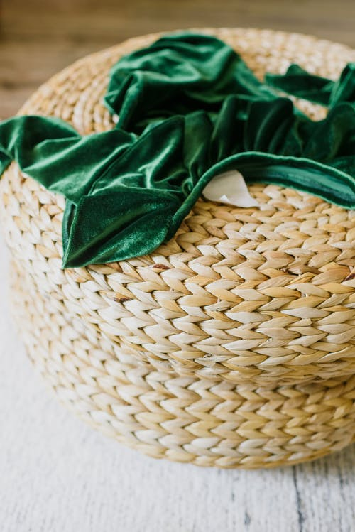 Green cloth placed on rattan pouf