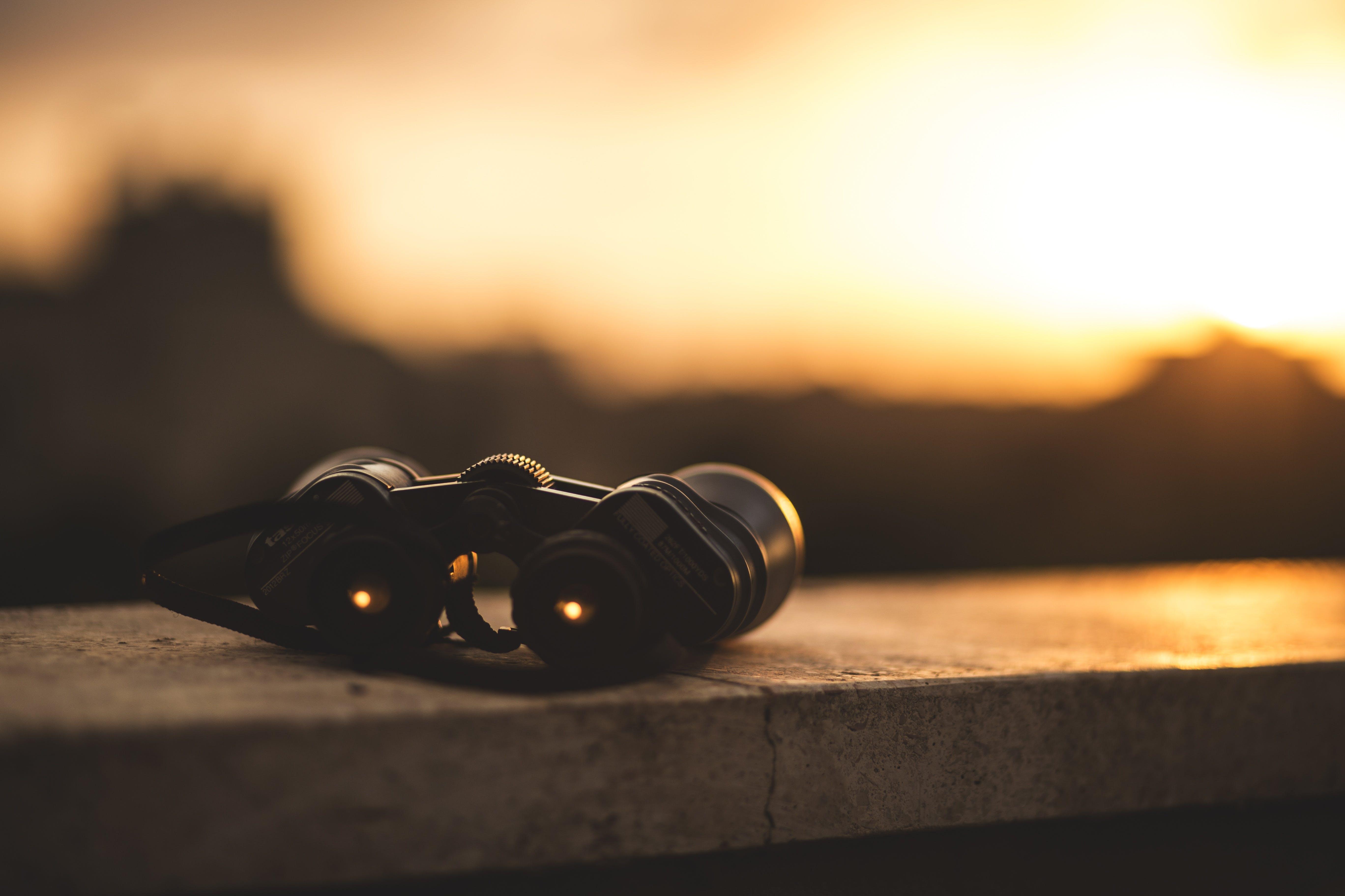 Black Binocular on Grey Concrete Frame