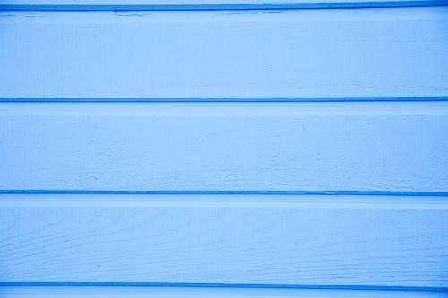 Blue Horizontal Lines on Light Blue Surface
