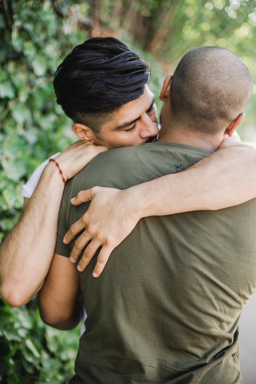 Two Men Hugging · Free Stock Photo