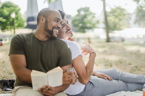 Two Happy Men Sitting Outside