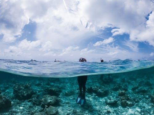 Unrecognizable snorkeler standing in warm blue seawater