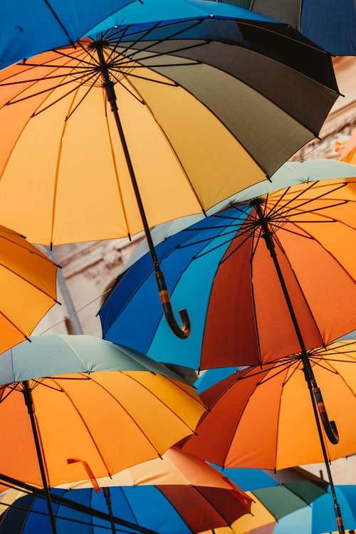 Orange Umbrella Under Blue Sky