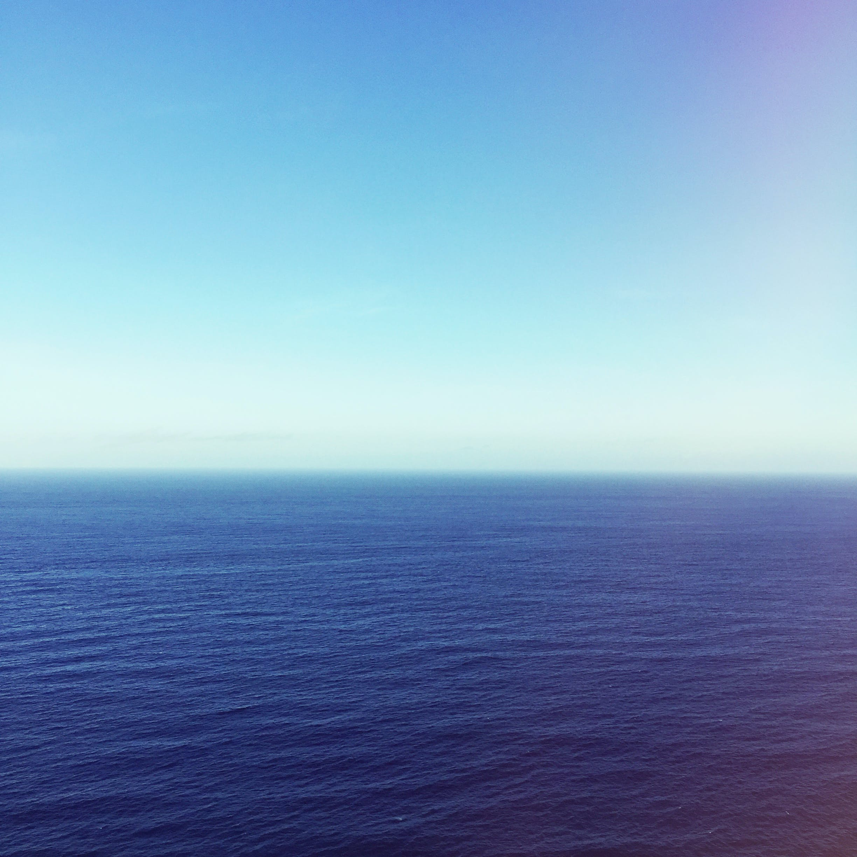 Wavy Blue Ocean Under Blue Sky