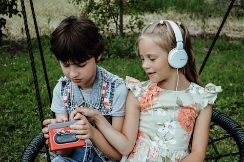 Kids listening to music in park