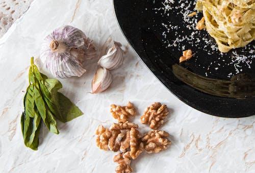 White Garlic Beside Garlic and Garlic