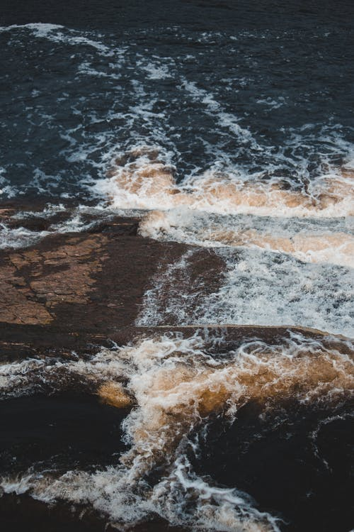 Stormy sea with rocky shore