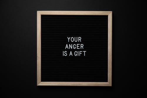 Blackboard with phrase YOUR ANGER IS A GIFT