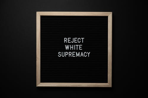 Chalkboard with REJECT WHITE SUPREMACY inscription