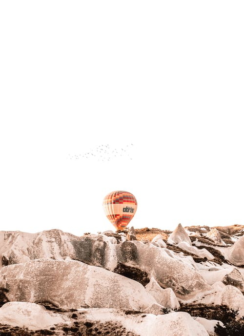 Red Hot Air Balloon on Gray Rock