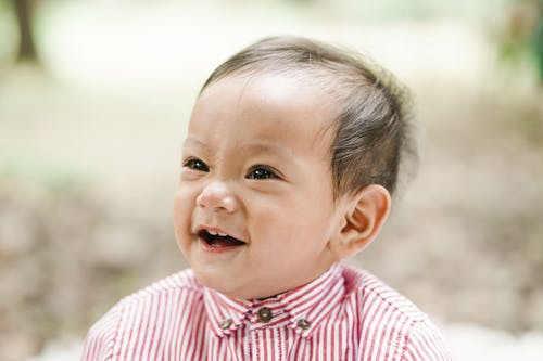 Close-Up Shot of a Baby Boy Smiling