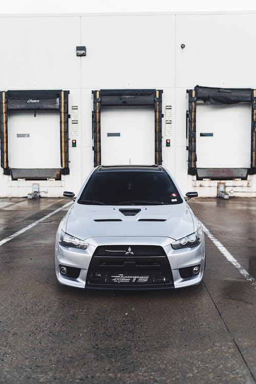 White Honda Car Parked on Parking Lot