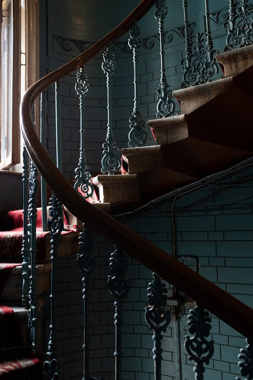 Brown Wooden Staircase With Stainless Steel Chain