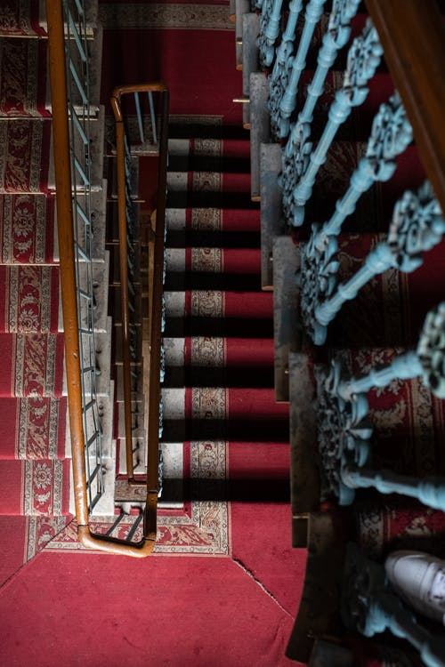 Brown and White Metal Staircase