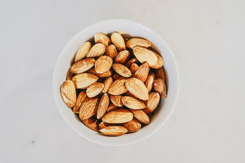 Brown Almond Nuts on White Ceramic Bowl