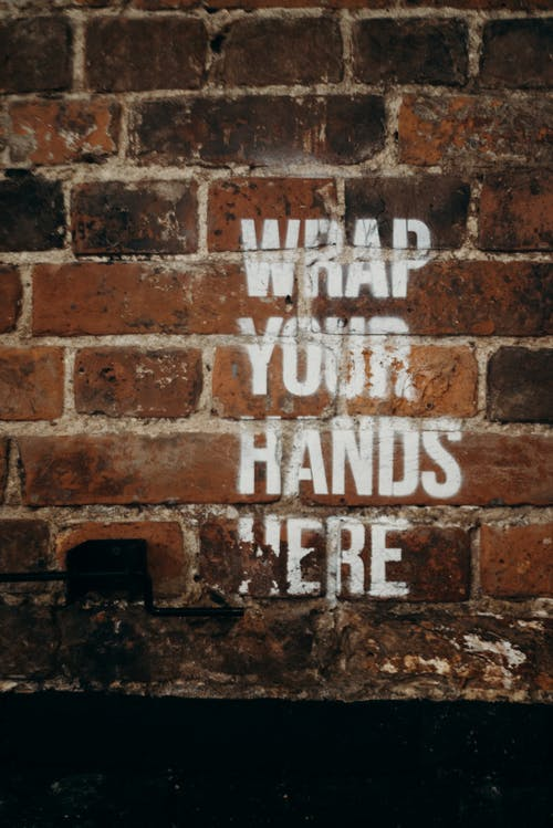 Brown Brick Wall With White and Black Quote