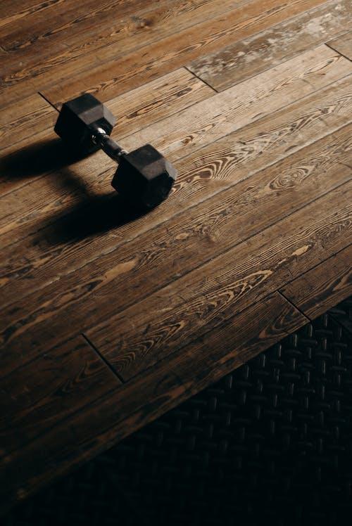 Black Metal Tool on Brown Wooden Table