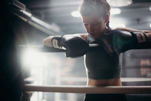 Woman in Black Sports Bra and Black Leggings Doing Exercise