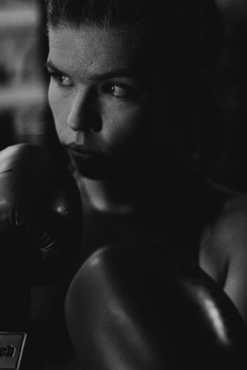 Topless Man With Black Boxing Gloves