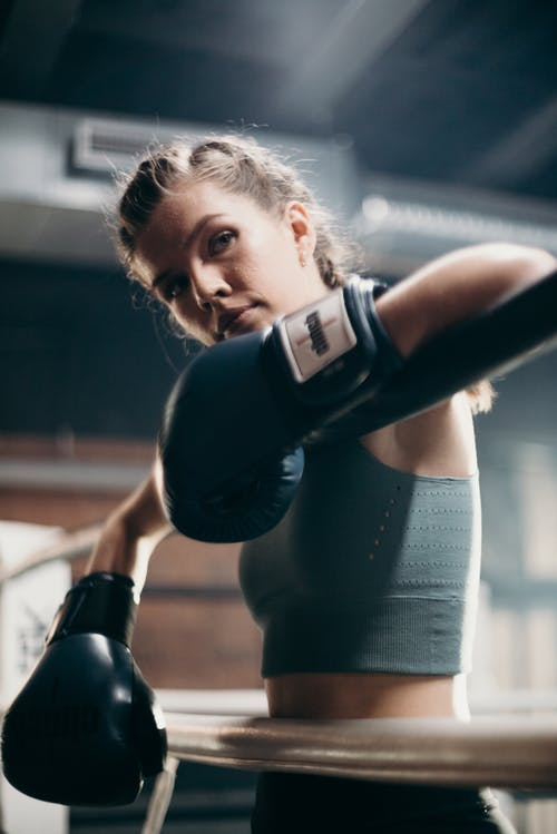 Woman in Black Tank Top and Black Boxing Gloves