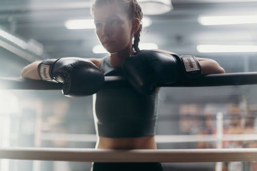 Woman in Black Boxing Gloves