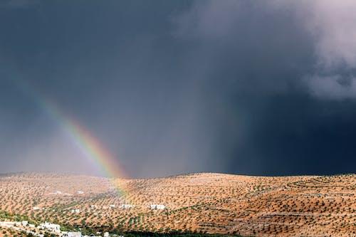 Foto d'estoc gratuïta de a l'aire lliure, alba, arc de Sant Martí, capvespre