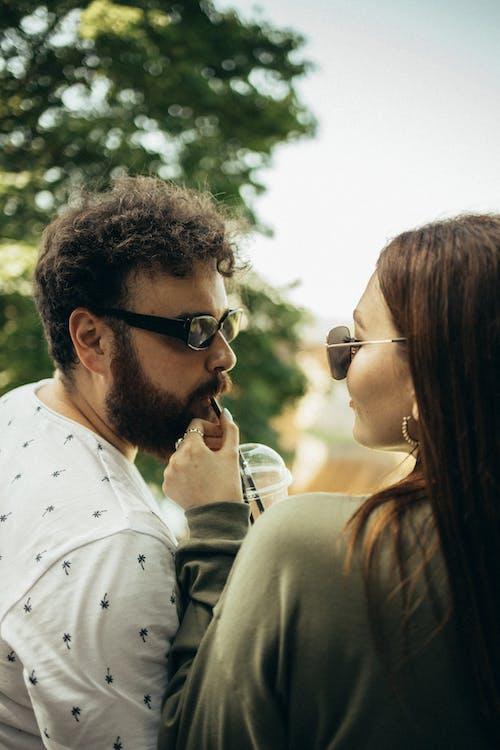 Man in White Dress Shirt Wearing Black Sunglasses
