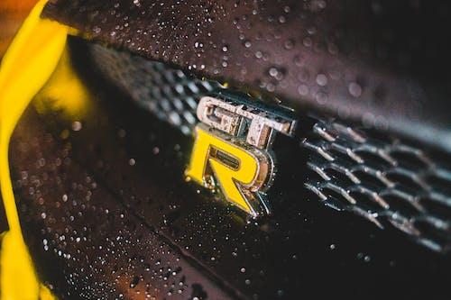 Yellow detail on wet modern car