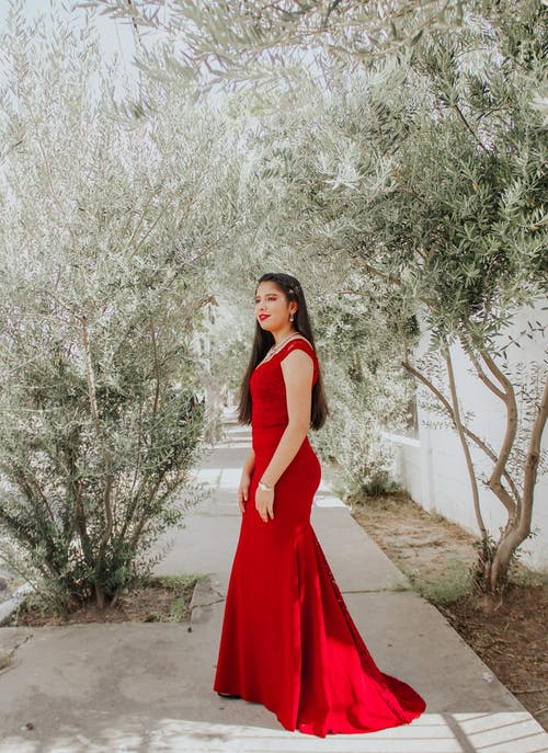 Charming woman in red gown