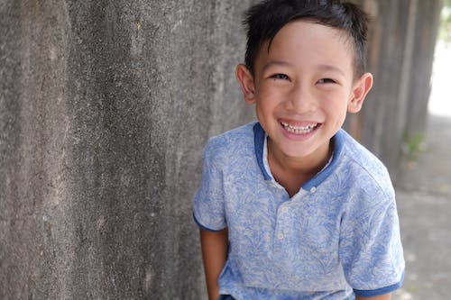 Boy in Blue Polo Shirt Smiling