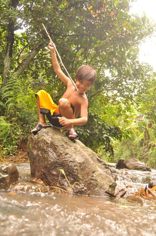 Free stock photo of child, children, fishing, stick fishing