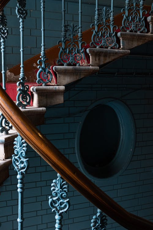 Brown Wooden Spiral Staircase With White Metal Railings