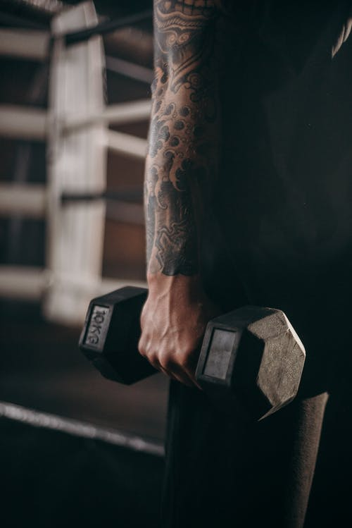 Person Holding 2 Kg Dumbbell