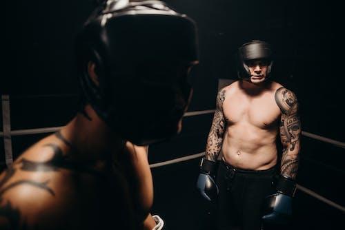 Topless Man Wearing Black Helmet
