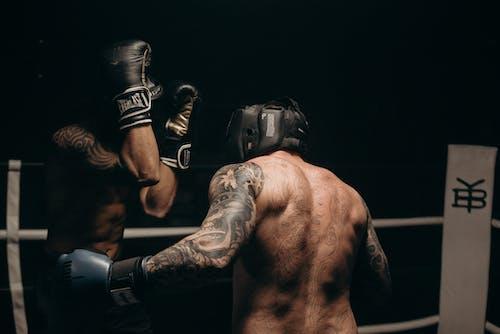 Man in Black Boxing Gloves
