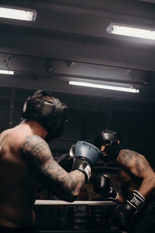 Man in Black Helmet and Black Helmet