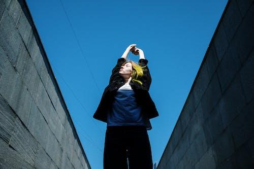 Man in Black Jacket Standing on Top of Building