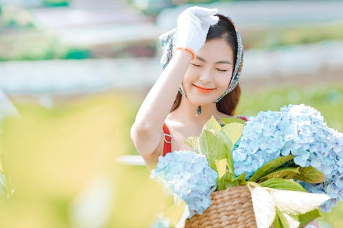 Happy Asian woman with bouquet