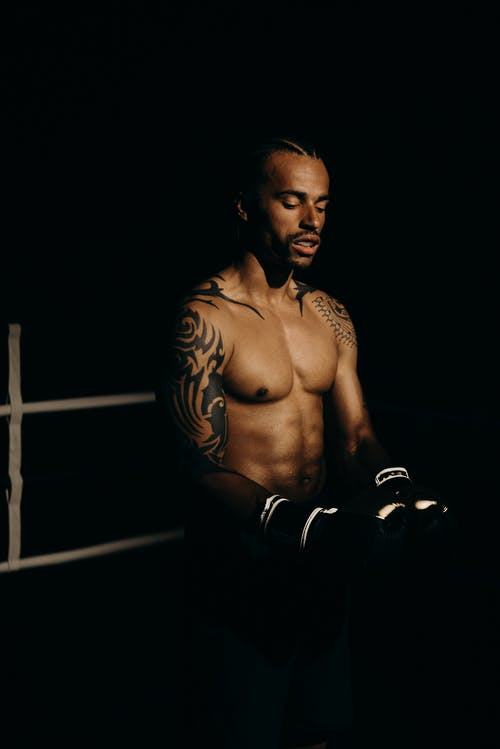 Topless Man in Black Pants and Black Boxing Gloves