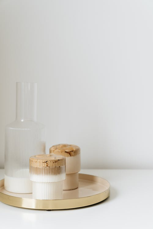 White Plastic Bottles on Brown Wooden Table
