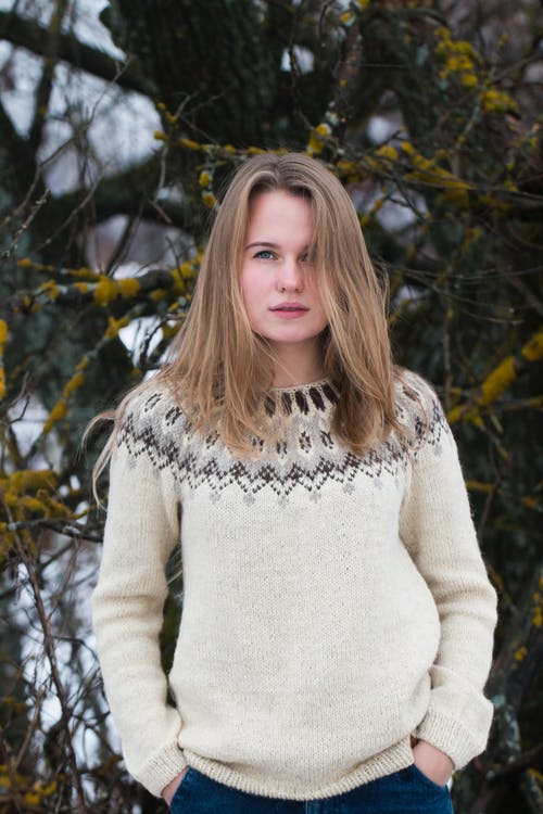 Woman in White Knit Sweater Standing Near Brown Tree