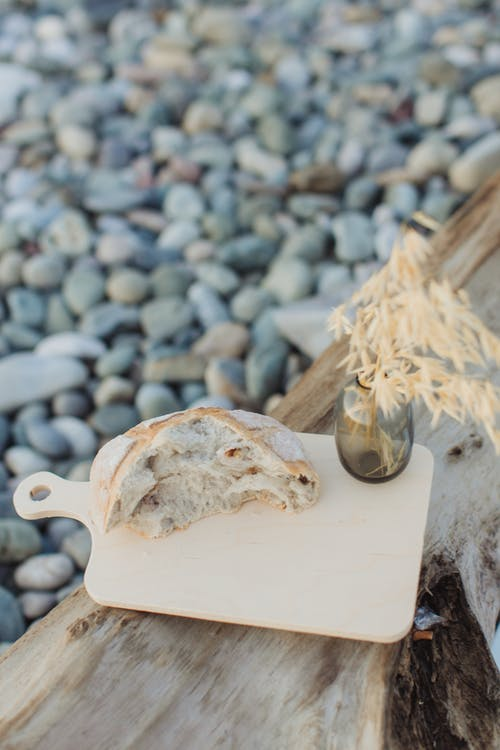 White Wooden Chopping Board With White and Brown Stone