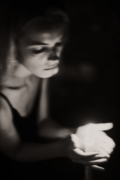 Woman With a Candle
