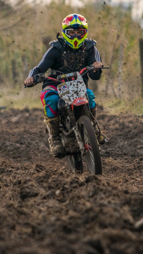 Man in Blue and Black Motorcycle Suit Riding Motocross Dirt Bike