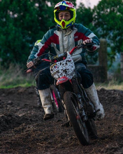 Man in Black and White Jacket Riding Motocross Dirt Bike