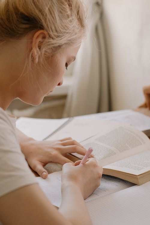 Girl in White Shirt Reading Book